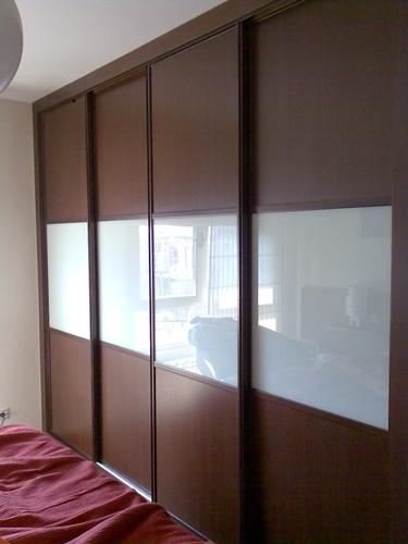 Puertas practicables armarios for Armario puertas correderas wengue